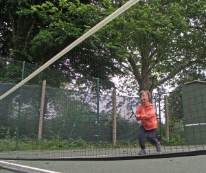 Joint Second Prize 7-11s: 'Serving at Marlow Tennis Club' Taken with self-timer 4/6/16 Nathaniel Horsley 8 yrs