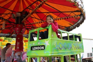 First prize Under 7s: 'Daisy on the Carousel' At carousel near Marlow Play Park 4/6/16 Scarlet Pendered aged 4
